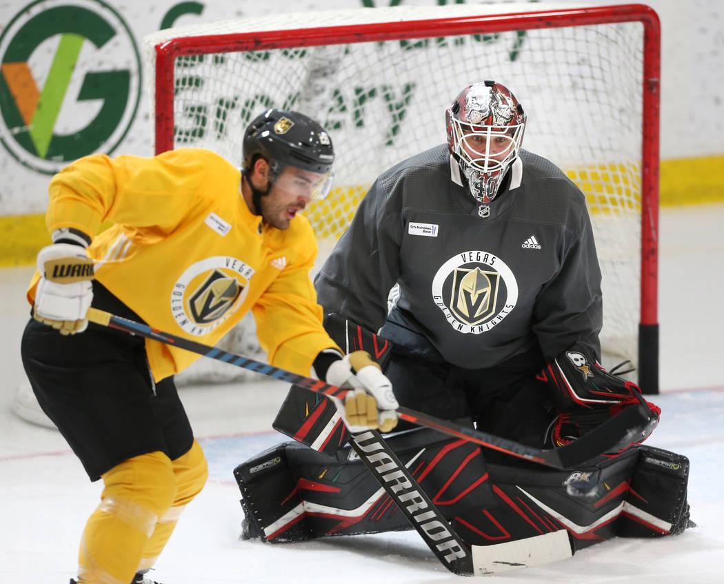 Vegas Golden Knights goaltender Robin Lehner defends a shot from William Carrier during a team ...