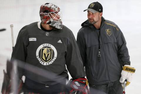 Vegas Golden Knights coach Peter DeBoer, right, talks to new team goaltender Robin Lehner durin ...