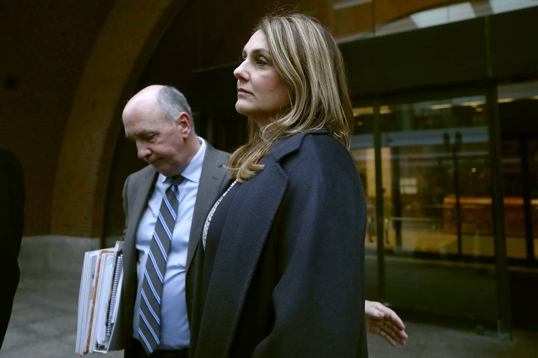 Michelle Janavs stands with attorney Thomas Bienert outside federal court, Tuesday, Feb. 25, 20 ...