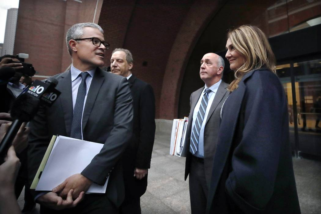 Attorney John Littrell, left, speaks to the media as client Michelle Janavs, right, stands besi ...