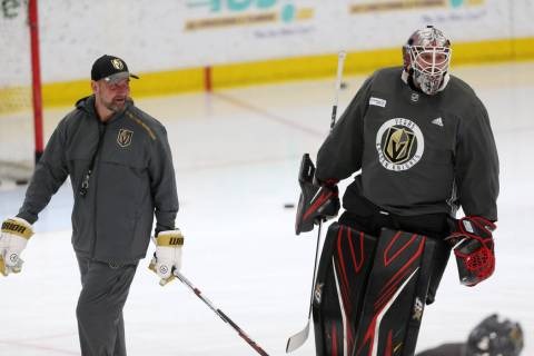 Vegas Golden Knights coach Peter DeBoer, left, talks to new team goaltender Robin Lehner during ...