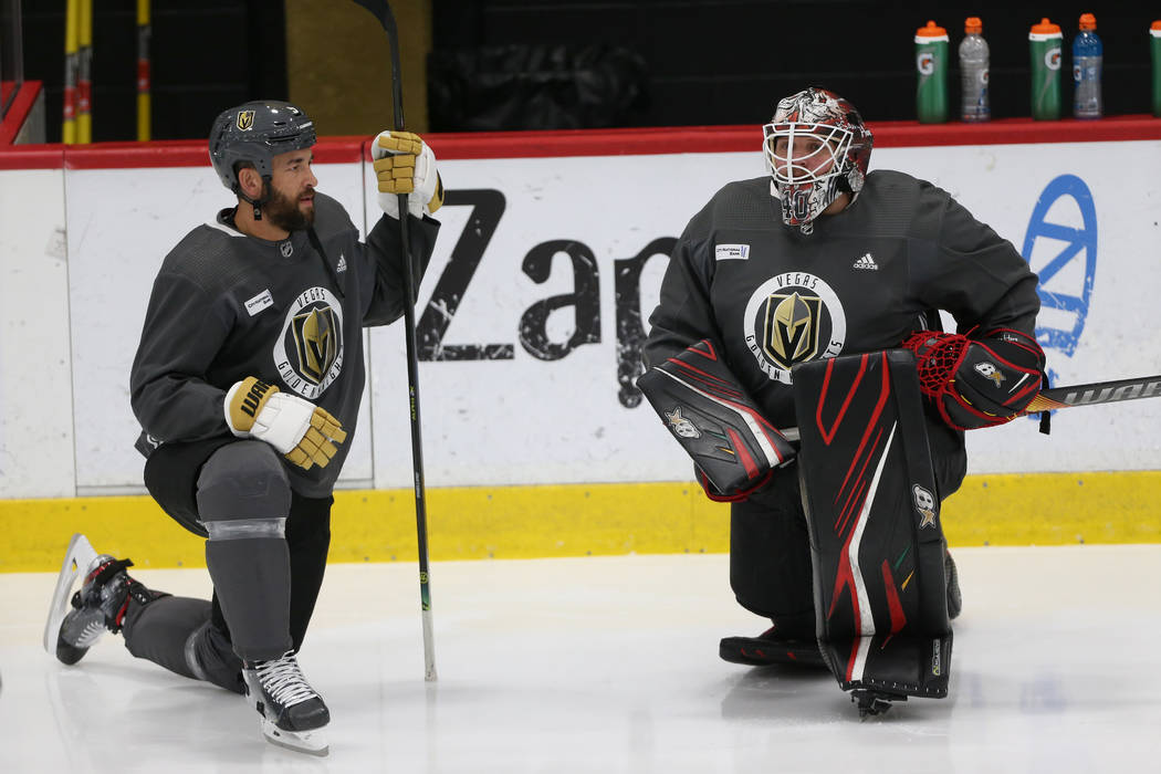 Vegas Golden Knights players Deryk Engelland, left, speaks to new team goaltender Robin Lehner ...