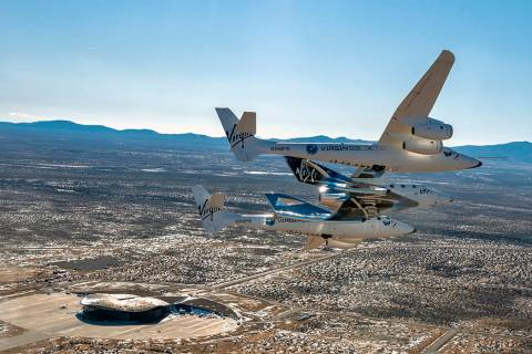 This photo provided by Virgin Galactic shows the Virgin Galactic's VSS Unity flying over Spacep ...