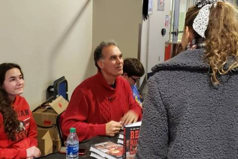 "Danny Tarkanian signs copies of his book, ""Rebel with a Cause,"" in the concourse of the Thomas ..."
