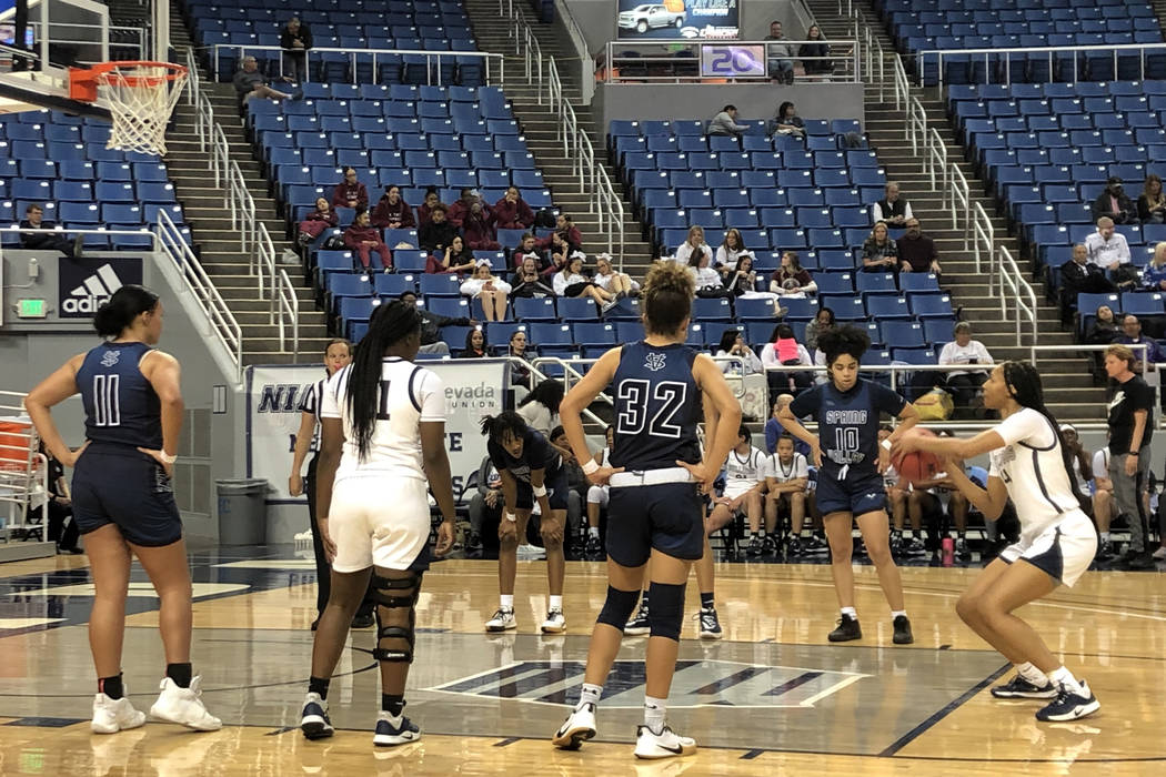 Centennial guard Taylor Bigby shoots a free throw during the fourth quarter of a 62-37 victory ...