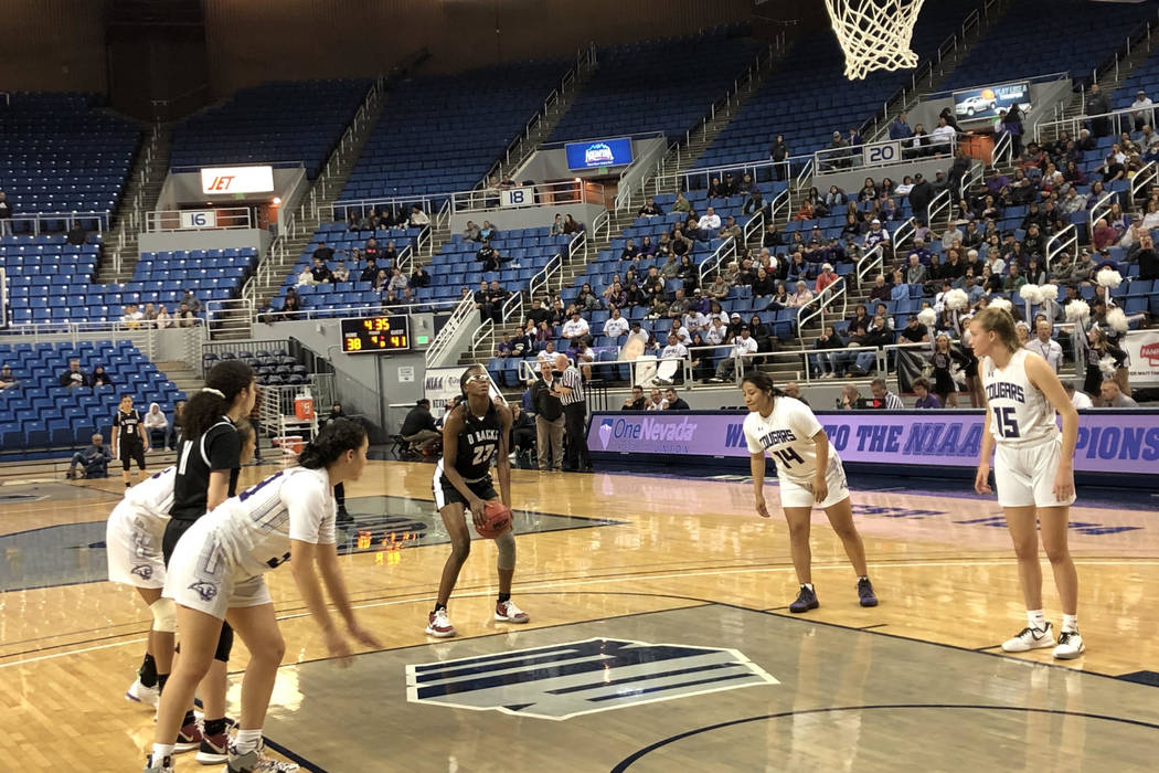 Desert Oasis forward Desi-Rae Young shoots a free throw during the fourth quarter of a 56-48 vi ...