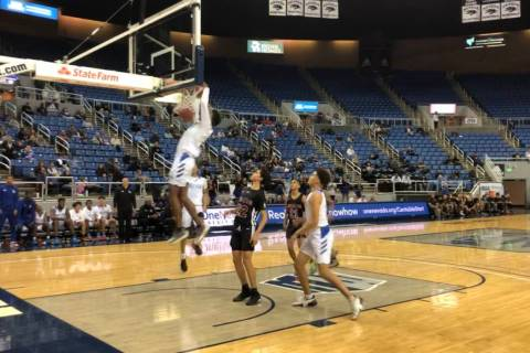 Desert Pines junior guard Dayshawn Wiley dunks during the second half of a 72-50 victory over D ...