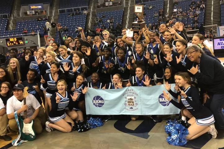 Centennial's girls basketball team poses with the school's band and cheerleaders after a 79-51 ...