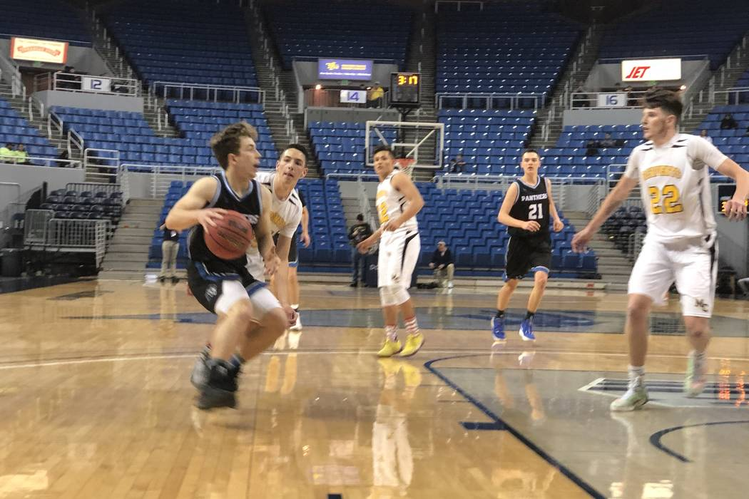 Pahranagat Valley senior guard John Hansen attacks the basket in the fourth quarter of a 50-38 ...