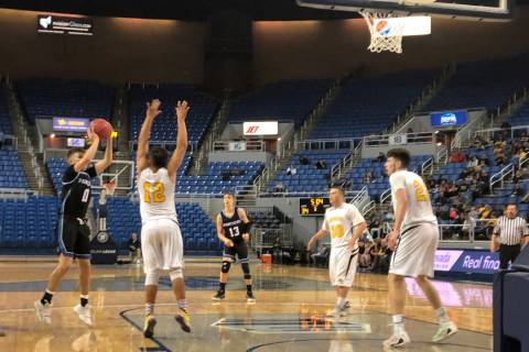 Pahranagat Valley senior guard Preston Higbee shoots a jumper in the third quarter of a 50-38 l ...