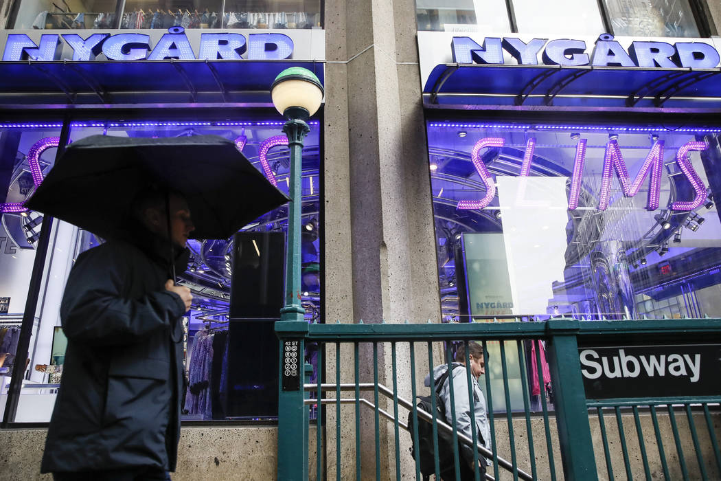 Pedestrians pass the storefront of Peter Nygard's Times Square headquarters, Tuesday, Feb. 25, ...