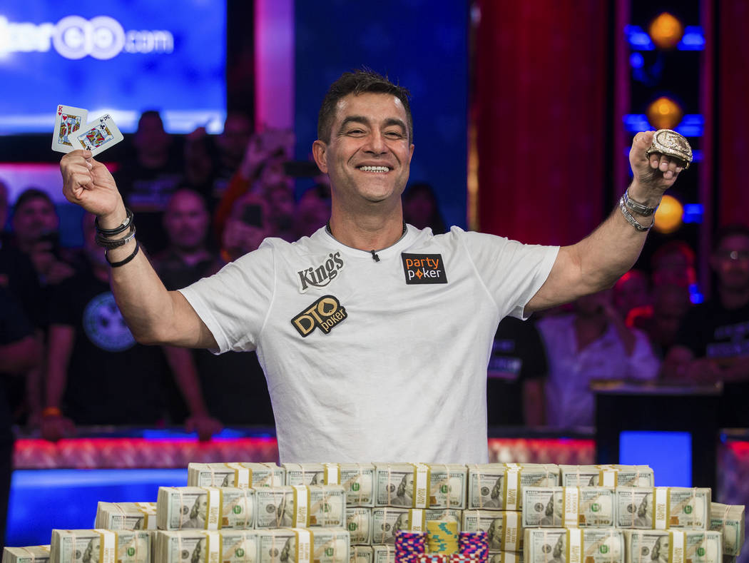 Hossein Ensan, from Germany, celebrates after winning the World Series of Poker Main Event on W ...