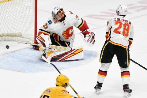 A shot by Nashville Predators center Mikael Granlund (64), of Finland, gets past Calgary Flames ...
