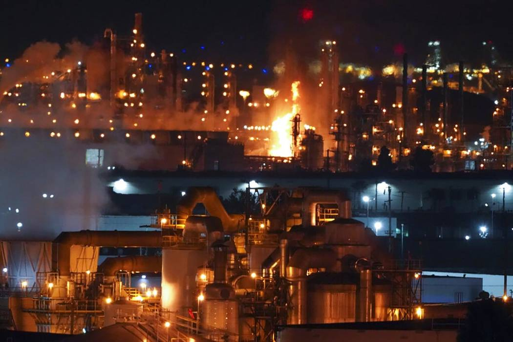 A fire burns after an explosion at the Marathon Refinery in Carson, California, on Tuesday, Fe ...