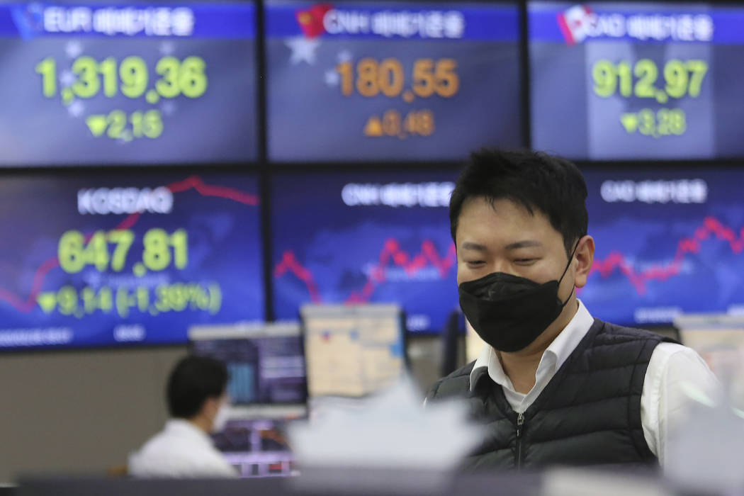 A currency trader watches monitors at the foreign exchange dealing room of the KEB Hana Bank he ...