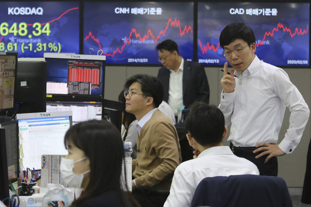 Currency traders work at the foreign exchange dealing room of the KEB Hana Bank headquarters in ...