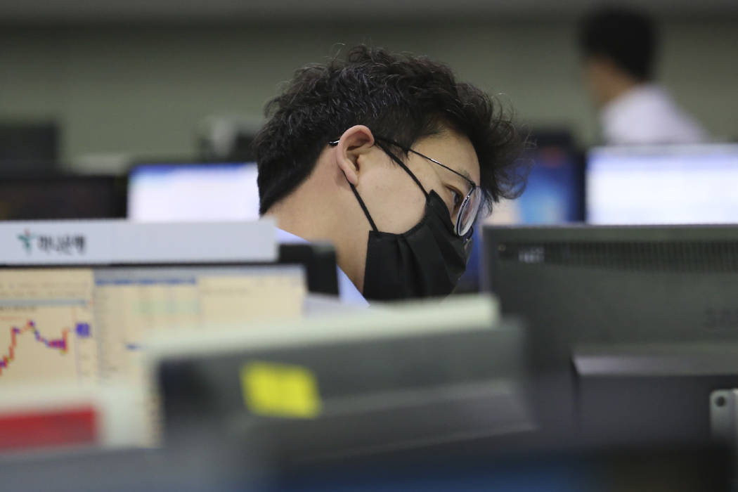 A currency trader watches monitor at the foreign exchange dealing room of the KEB Hana Bank hea ...