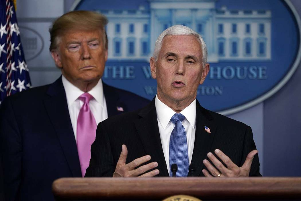 President Donald Trump listens as Vice President Mike Pence speaks during a news conference abo ...