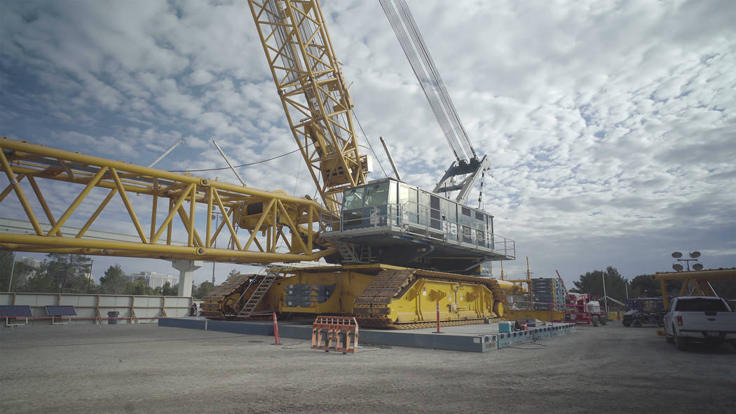 Weighing 869 tons, the DEMAG CC-8800 sits on top of specially designed steel mats because the g ...