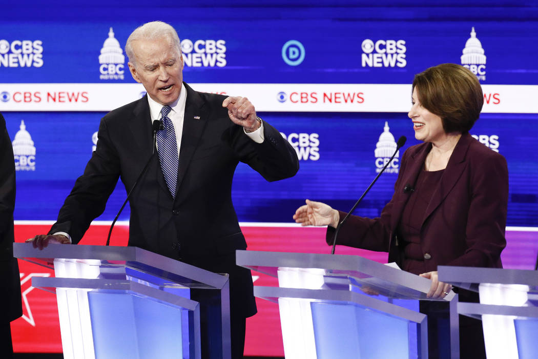 Democratic presidential candidates, former Vice President Joe Biden, left, and Sen. Amy Klobuch ...