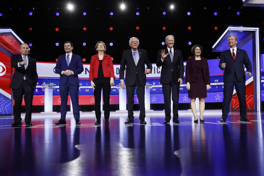 From left, Democratic presidential candidates, former New York City Mayor Mike Bloomberg, forme ...