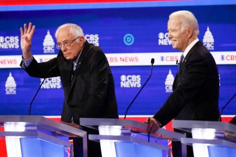 Democratic presidential candidates, Sen. Bernie Sanders, I-Vt., left, and former Vice President ...