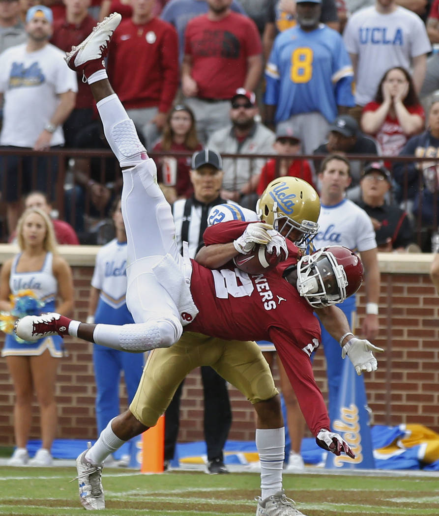 Oklahoma wide receiver CeeDee Lamb (2) comes down with a touchdown pass in front of UCLA defens ...
