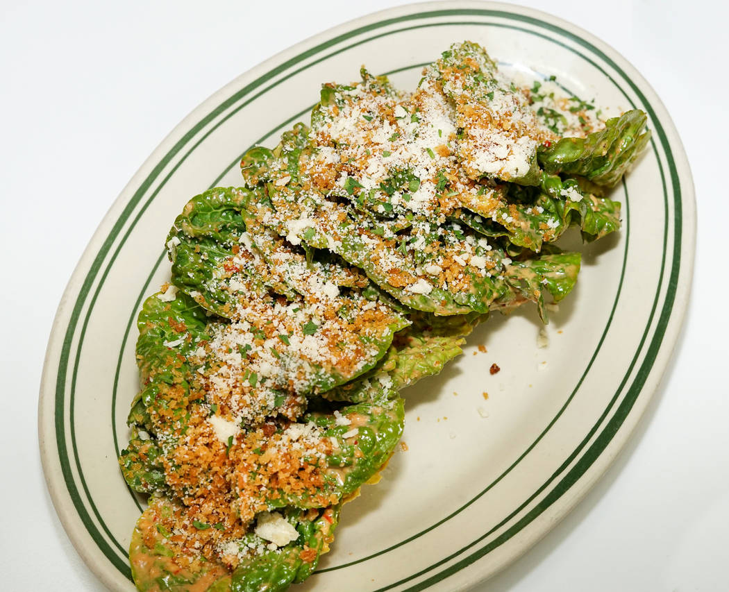 Gem lettuce with Calabrian chili dressing and Parmesan. (Erica Gould)