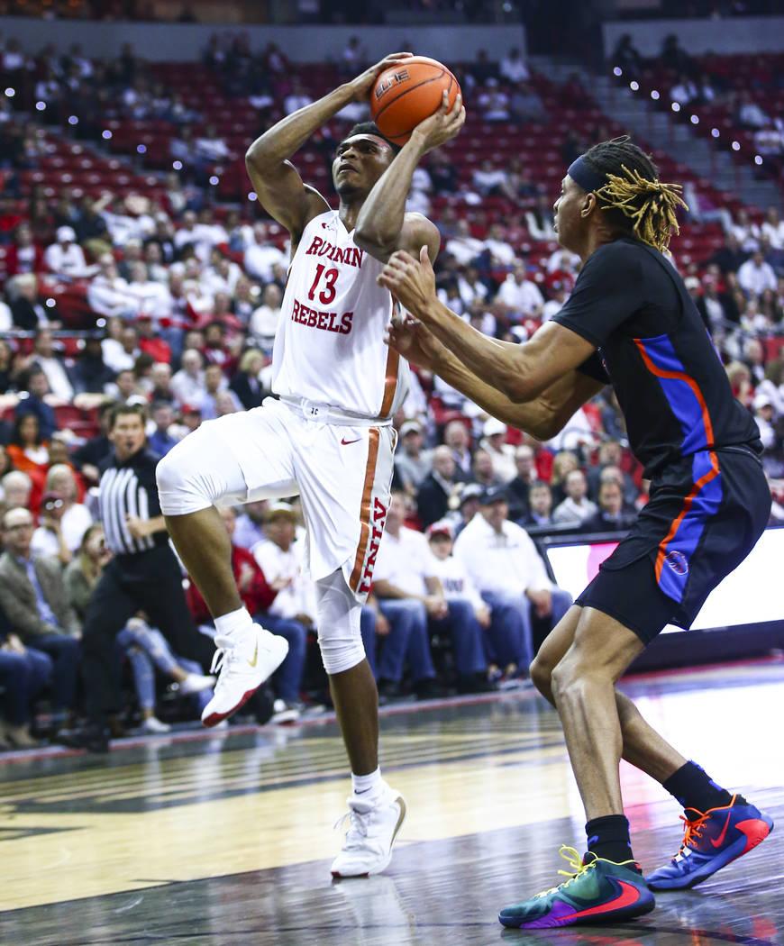 UNLV Rebels' Bryce Hamilton (13) goes to the basket past Boise State Broncos' Derrick Alston (2 ...