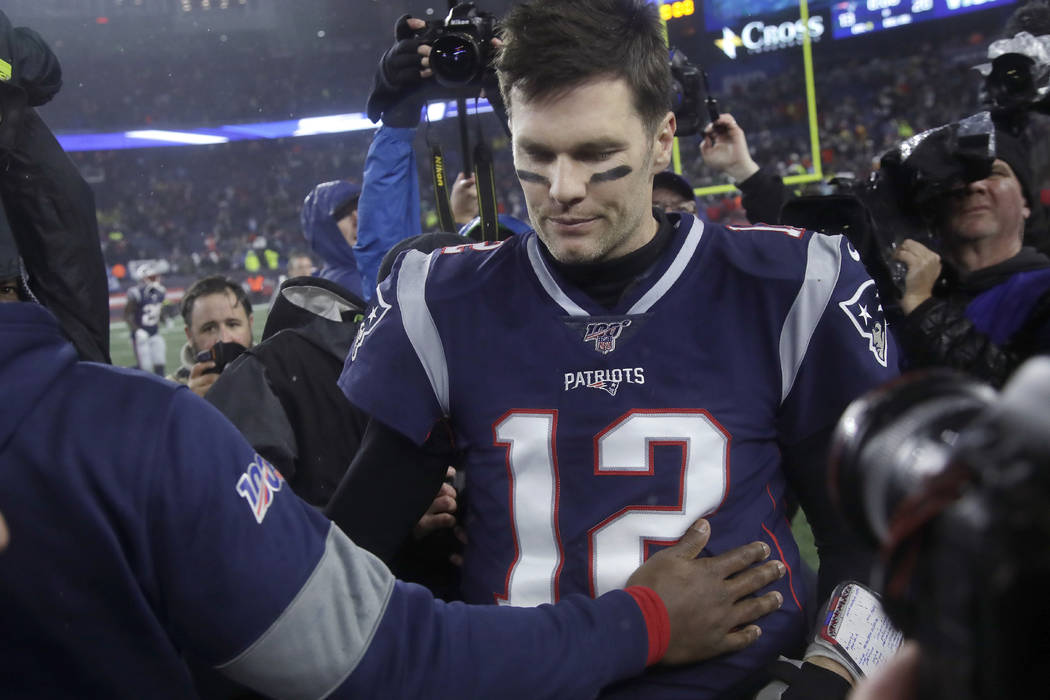 New England Patriots quarterback Tom Brady leaves the field after losing to the Tennessee Titan ...