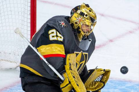 Vegas Golden Knights goaltender Marc-Andre Fleury (29) deflects another shot on goal from the W ...