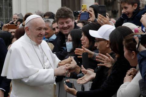 Pope Francis salutes faithful in St. Peter's Square at the Vatican before leaving after his wee ...