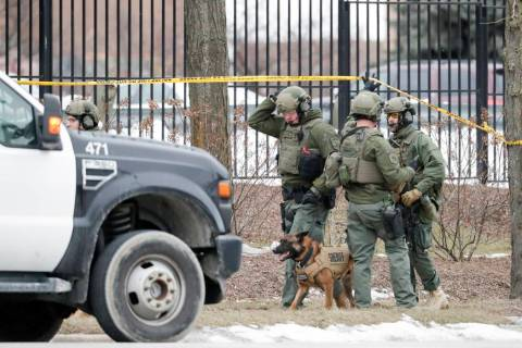 Police work outside the Molson Coors Brewing Co. campus in Milwaukee on Wednesday, Feb. 26, 202 ...