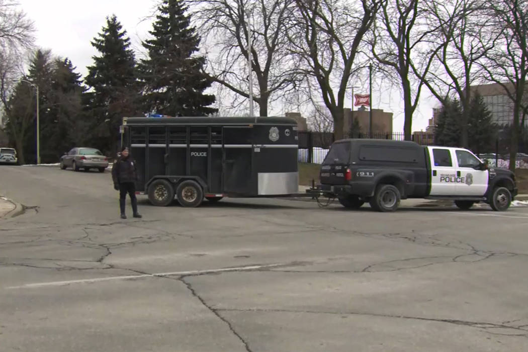 This image provided by WISN-TV, police respond to a possible shooting at the MillerCoors campus ...
