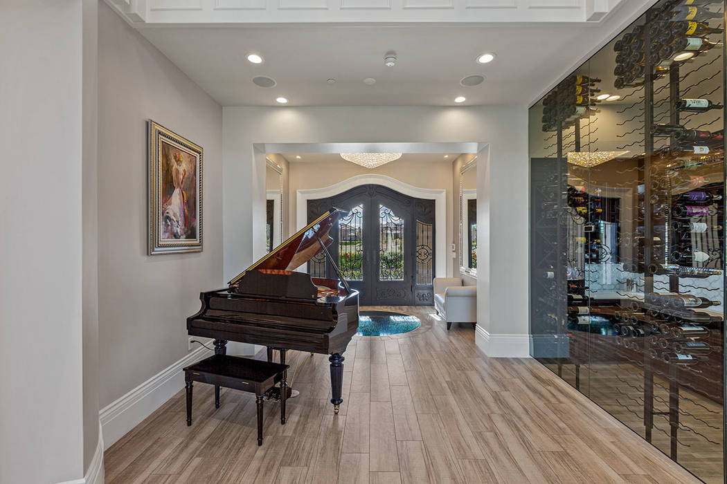 The entry leads to a wine room. (Ivan Sher Group)