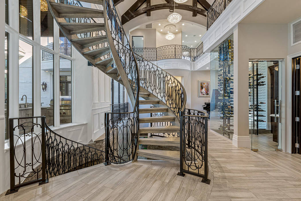 The home features a dramatic spiral staircase with custom ironwork. (Ivan Sher Group)