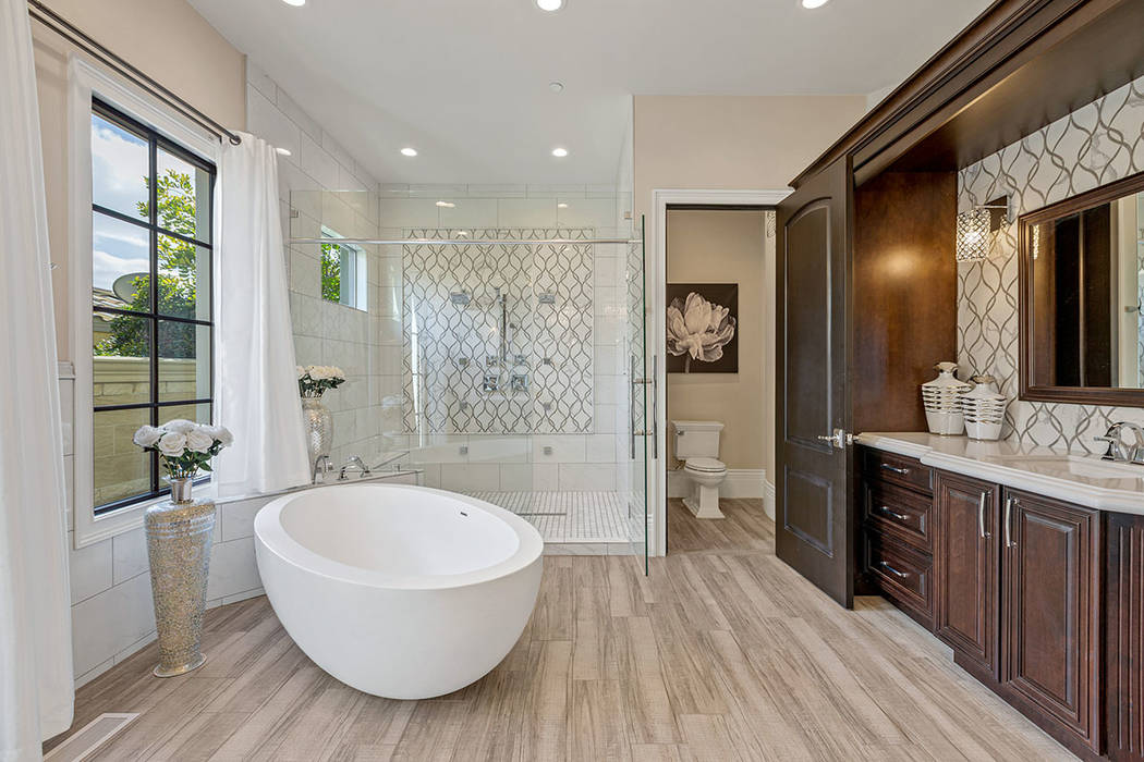 The master bath features an oval soaking tub. (Ivan Sher Group)