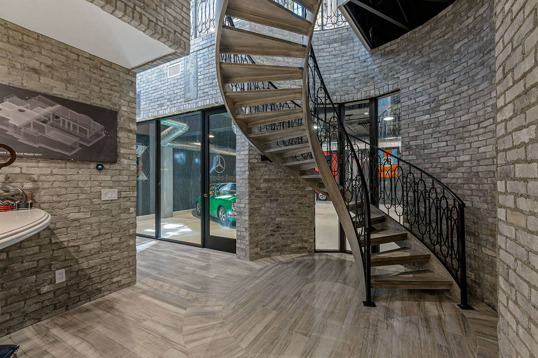 The custom staircase leads to the unique garage. (Ivan Sher Group)