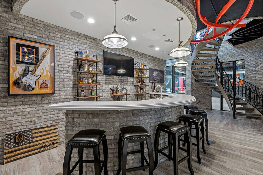 The 5,000-square-foot basement has a bar. (Ivan Sher Group)