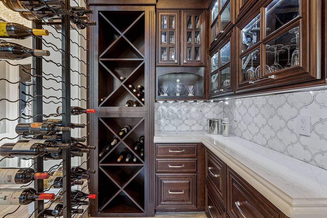 For wine enthusiasts, a wine cellar off the main entry can store 800-plus bottles. (Ivan Sher G ...