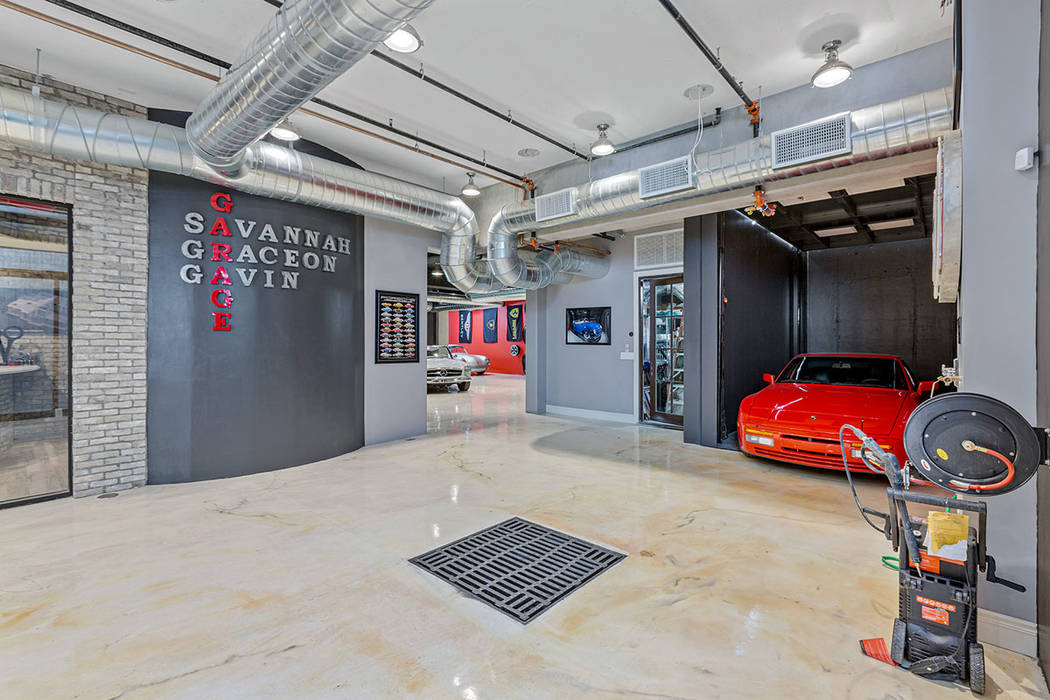 The two-level garage has an elevator to transport cars. (Ivan Sher Group)