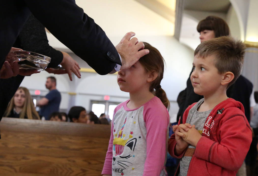 Michael Lepoie, 4, right, a pre-K student at St. Viator Catholic School, watches as his classma ...
