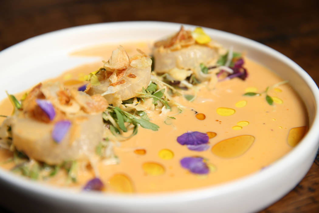 The scallop sashimi is served with sesame-uni leche de tigre and crispy onion, at Once restaura ...