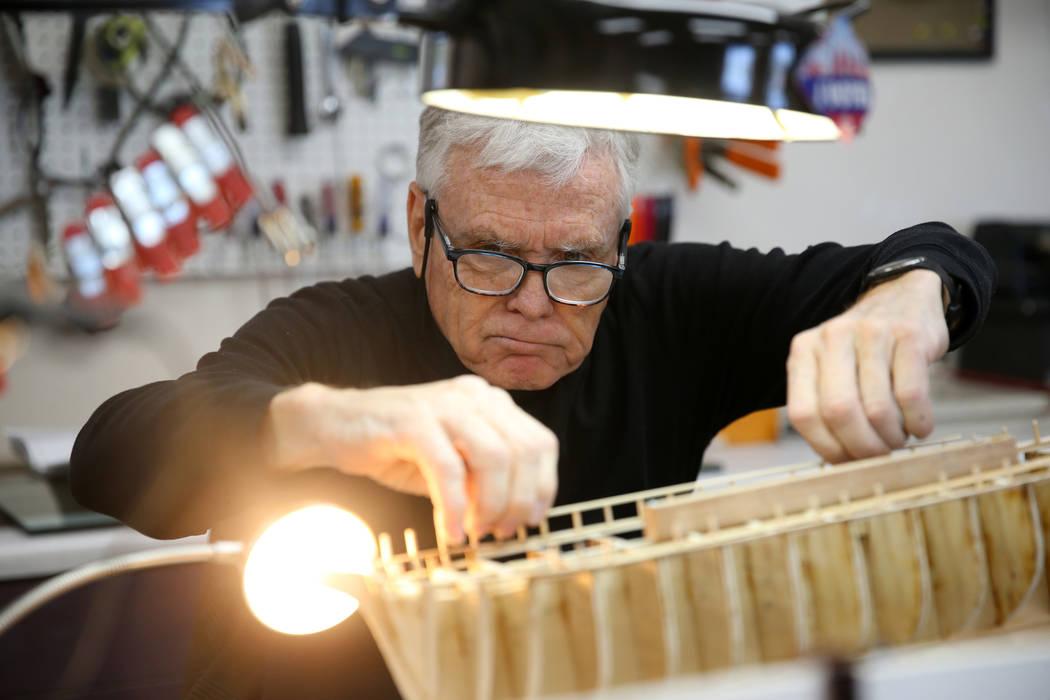U.S. Air Force veteran Jim Twohig works on a ship model at Desert Vista Community Center in Las ...