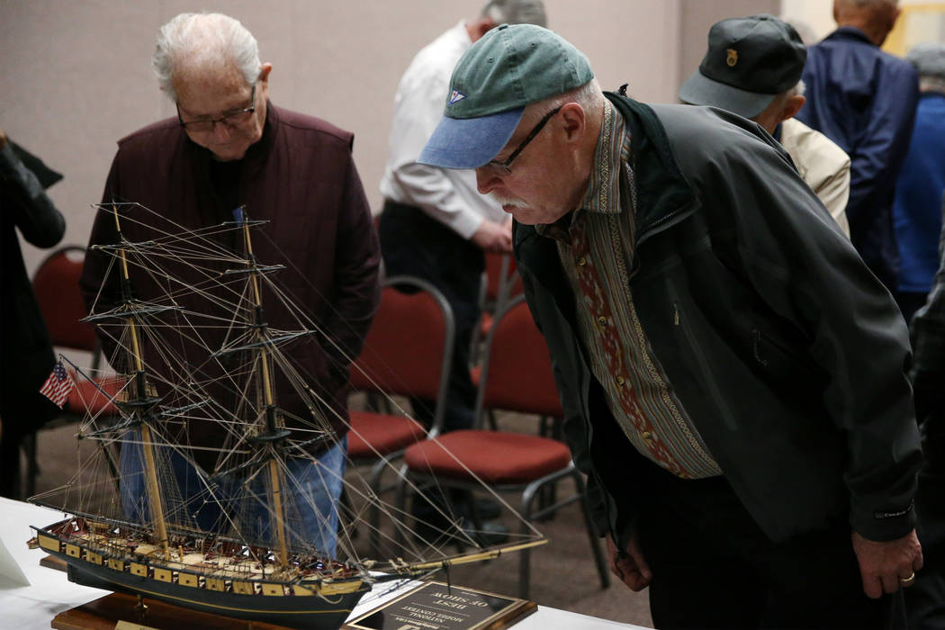 Jim Huehnergarth, right, a U.S. Air Force veteran visiting from Bellevue, Wash., looks at the U ...
