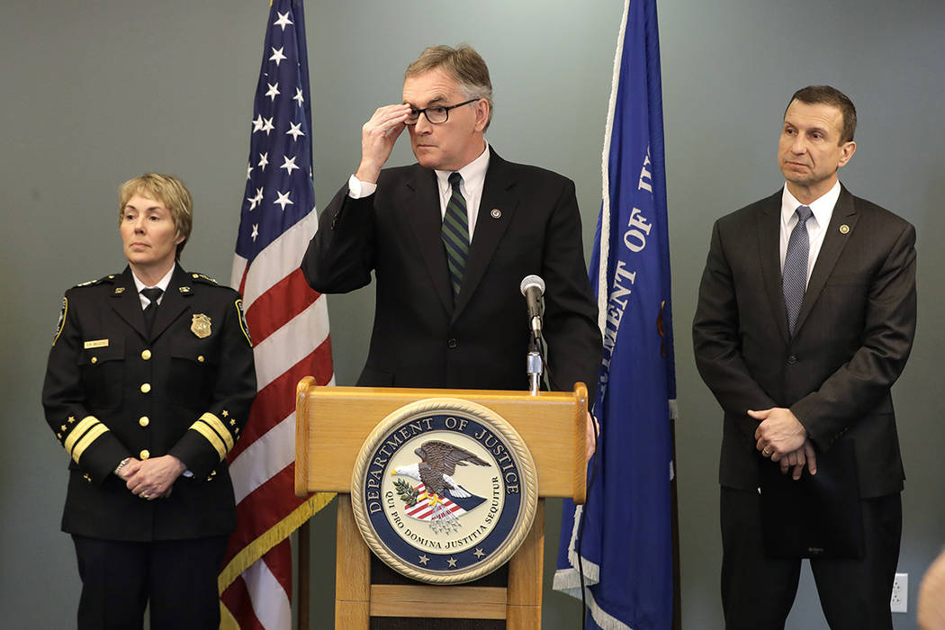 U.S. Attorney Brian Moran, center, is flanked by Seattle assistant chief of police Deanna Nolle ...