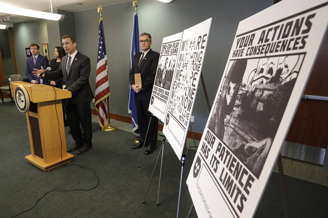 Raymond Duda, FBI Special Agent in Charge in Seattle, speaks during a news conference at a podi ...