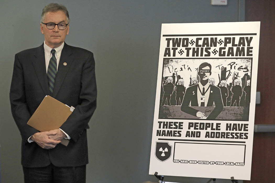 U.S. Attorney Brian Moran stands next to a poster that was mailed earlier in the year to the ho ...