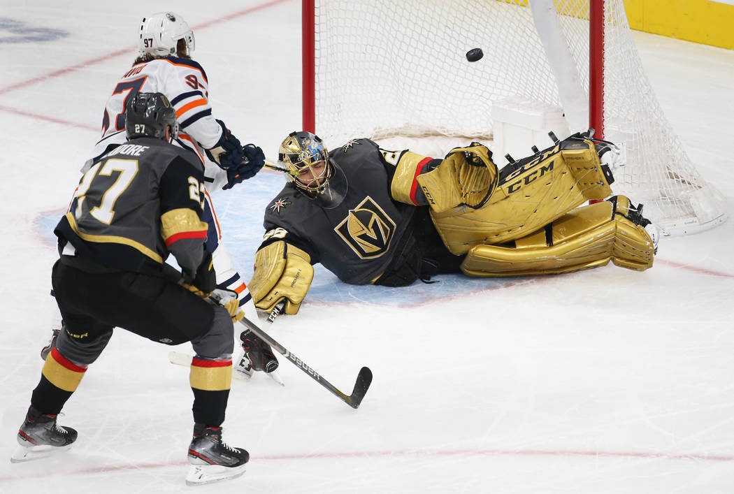 Vegas Golden Knights goaltender Marc-Andre Fleury (29) makes a diving save against Edmonton Oil ...