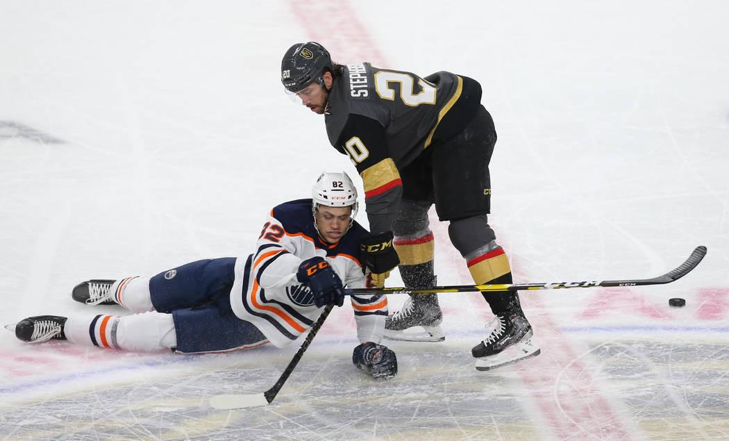 Vegas Golden Knights center Chandler Stephenson (20) collides with Edmonton Oilers defenseman C ...